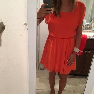Orange loose fitted dress.